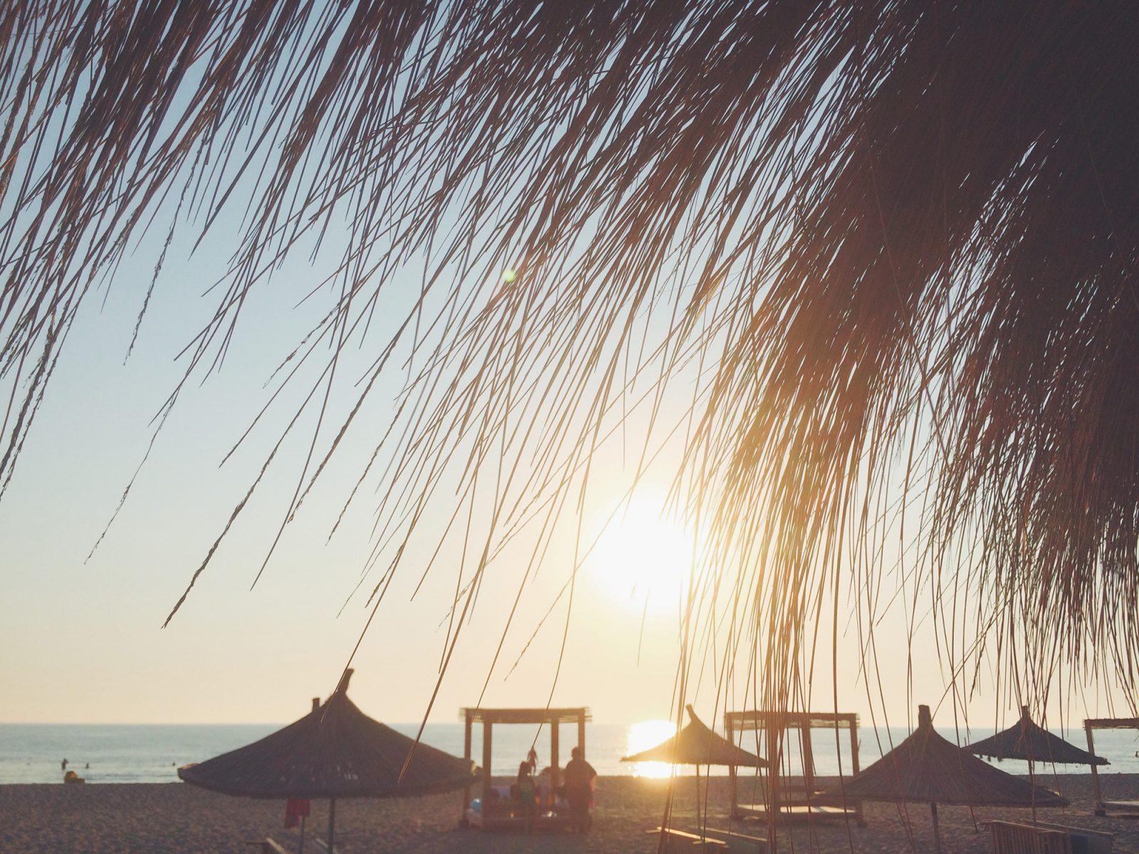 Sunset-and-parasols-gjiri-i-lalzit-beach